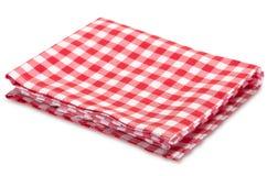 在白色隔绝的厨房红色野餐水平的衣裳 库存图片