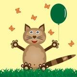 在草的滑稽的猫发布气球 飞行蝴蝶 图库摄影