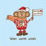 逗人喜爱的圣诞节猴子 免版税图库摄影