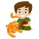 打与他的猫的男孩一个球 图库摄影