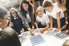 Студенты школьного учителя уча уча концепцию Стоковая Фотография