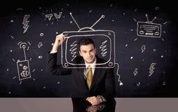 画电视和收音机的愉快的商人 免版税库存图片