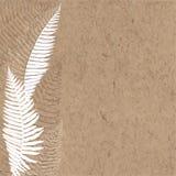 与蕨的手拉的背景在牛皮纸 免版税库存照片