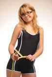 Тучная девушка с измеряя лентой Стоковое фото RF
