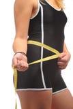 Торс девушки с измеряя лентой Стоковые Фото