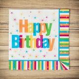 集会餐巾与标题生日快乐,庆祝题材 免版税库存照片