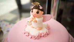 婴孩洗礼仪式方旦糖蛋糕 库存图片