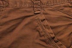 布朗牛仔裤前面口袋 库存图片