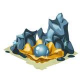 在金黄壳的蓝色珍珠在岩石中 库存图片