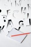 象纸字母表的笔记本 库存图片