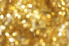 свет предпосылки золотистый Стоковые Изображения