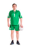 在绿色运动服摆在打扮的成熟人 免版税库存照片