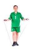 在绿色运动服摆在打扮的成熟人 库存照片