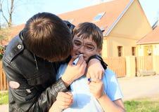 在男孩的面孔的年轻人图画 图库摄影