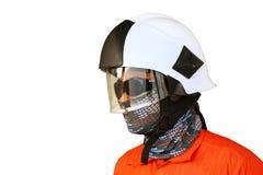在油和煤气产业的消防队员,成功的消防队员在工作,战斗机的火衣服与火和衣服为保护火 免版税图库摄影