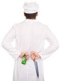 нож зеленого цвета кашевара бутылки Стоковое фото RF