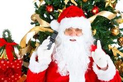 蜂窝电话圣诞老人微笑 库存照片