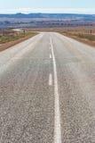 在澳洲内地西澳州的空的路 免版税库存图片