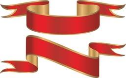 χρυσές κόκκινες κορδέλλες εμβλημάτων Στοκ Φωτογραφίες