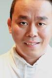 男性亚洲有裂缝的眼睛 免版税库存照片