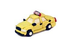 Автомобиль такси пластилина изолированный на белой предпосылке Стоковые Изображения