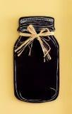 金属螺盖玻璃瓶黑板 免版税库存图片