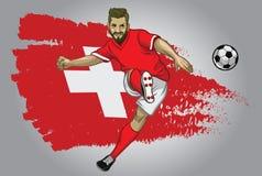 Ποδοσφαιριστής της Ελβετίας με τη σημαία ως υπόβαθρο Στοκ Εικόνες