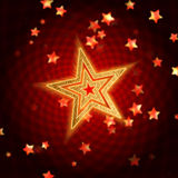 金黄红色螺旋星形 免版税库存图片