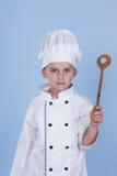 一个小男孩当厨师厨师 免版税库存图片
