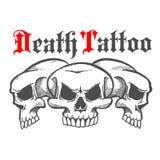 小组死亡纹身花刺的头骨 库存图片