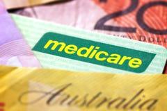 澳大利亚人医疗保障卡片和金钱 免版税图库摄影