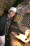 шеф-повар варя обед Стоковое Изображение