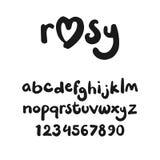 在小写手写的逗人喜爱的字体与标志 库存图片