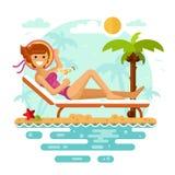热带海滩的晒日光浴的女孩 库存照片