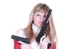 女孩开枪二个年轻人 免版税库存图片