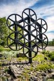 轮子齿轮雕塑 免版税库存照片