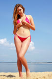 性感海滩的女孩 免版税库存图片