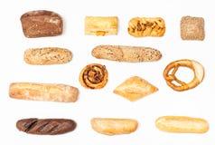 各种各样的新鲜的小圆面包和大面包在白色背景 免版税库存照片