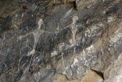 有历史的岩石的碑文 免版税库存照片