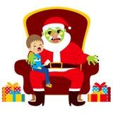 有孩子的圣诞老人蛇神 免版税库存图片