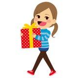 拿着礼物的女孩 免版税库存图片