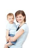 她的母亲微笑的儿子 库存图片