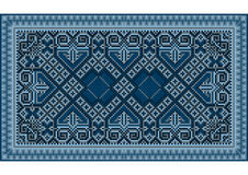 有深蓝的一张被提炼的豪华葡萄酒东方地毯 库存照片