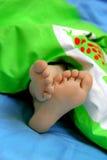 睡着的脚趾 免版税库存图片