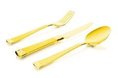 扁平的餐具金子 图库摄影