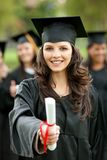 女性毕业纵向 免版税库存照片