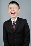 男孩笑 免版税库存照片