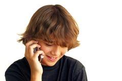 男孩移动电话微笑的联系少年 库存照片