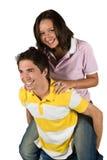 夫妇肩扛少年 库存图片
