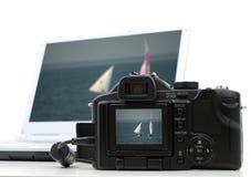 照相机笔记本照片 免版税库存照片